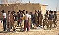 Afghan Local Police candidates take a break after a physical training class in the Nawbahar district, Zabul province, Afghanistan, March 10, 2012 120310-N-UD522-210.jpg