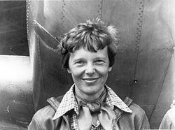 Amelia Earhart standing under nose of her Lockheed Model 10-E Electra, small.jpg