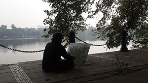 Rabindra Sarobar - An artist draws a tree in front of the lake