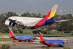 Asiana Airlines Airbus A380 landing at LAX whilst 2 Southwest 737-800s wait.jpg