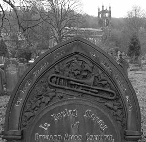 Sackbut - Trombone on a 1909 headstone, Christ Church, Todmorden