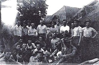 Balangiga massacre - Soldiers of Company C, 9th US Infantry Regiment with Valeriano Abanador (standing, sixth from right) in Balangiga in August 1901.