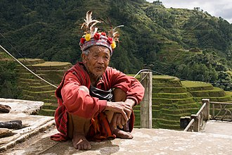 Igorot society - Man of the Ifugao tribe in traditional clothing.