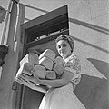 Barbara Smaile, one of the kitchen staff at the Women's Land Army break house at Torquay in 1944, brings in freshly baked bread. D20716.jpg