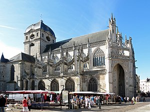 Basilica of Notre-Dame d'Alençon - A northern view of the basilica, showing its 18th-century steeple, flying buttresses, and the Gothic porch