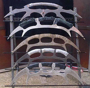 "Bat'leth - A collection of replica Bat'leths--note the replica of ""The Sword Of Kahless"" at the top."
