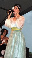 Becky Stark from Lavender Diamond singing onstage in a silver dress