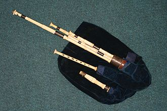 Northumbrian smallpipes - These Northumbrian smallpipes were made by John Dunn, and belonged to Robert Bewick. They have an inscription on the dronestock ferrule stating their provenance. It is likely that this simple chanter is not the original, which was probably keyed.