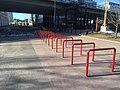 Bike racks and overpass (28179572118).jpg