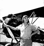 Bill Tankersley from the NYA's Camp Roosevelt posing in front of an airplane- Ocala, Florida (4155750819).jpg