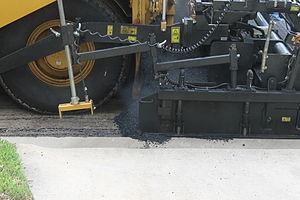 Asphalt concrete - Asphaltic concrete laying machine in operation in Laredo, Texas