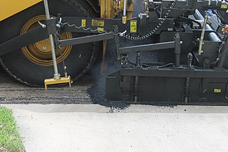 Asphalt concrete - Asphaltic concrete laying machine in operation in Laredo, Texas