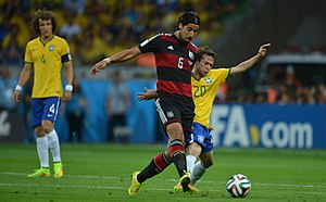 Sami Khedira - Khedira playing against Bernard at the 2014 FIFA World Cup.