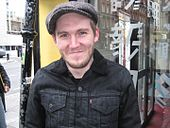 A shot of Brian Fallon, looking into a nearby camera.