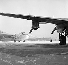 A Silver City Bristol 170 Freighter Mk 21 Seen Beyond The Wing Of An Avro  York On The Ramp At Berlin Tempelhof In January 1954.