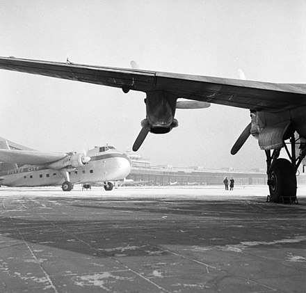 A Silver City Bristol 170 Freighter Mk 21 seen beyond the wing of an Avro York on the ramp at Berlin Tempelhof in January 1954. Bundesarchiv B 145 Bild-F001297-0011, Berlin, Flughafen Tempelhof.jpg