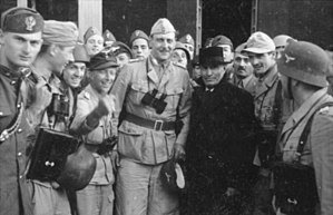 Otto Skorzeny - Skorzeny (centre, binoculars hanging from neck) with the liberated Mussolini – 12 September 1943