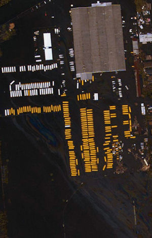 Criticism of government response to Hurricane Katrina - Aerial view of flooded New Orleans school buses.