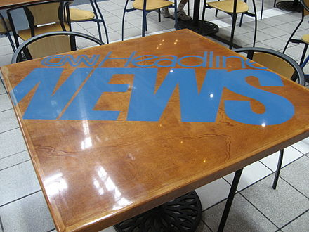 1997–2001 CNN Headline News logo on a table in the food court at CNN Center. Tables like these have since been removed.