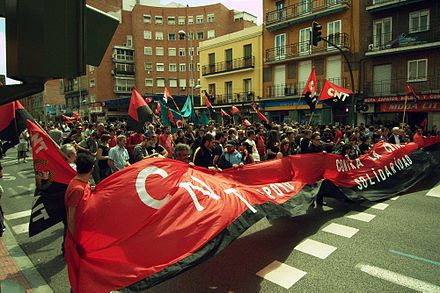 Members of the Spanish anarcho-syndicalist trade union Confederacion Nacional del Trabajo marching in Madrid in 2010 CNT-1mayo2010.jpg