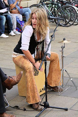 Cajón - A street musician (Heidi Joubert) playing a decorated cajón