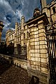 Cambridge - Trinity Lane - Clare College, founded in 1326 - View NE on Clare's Entrance Gate & Old Schools 1890.jpg