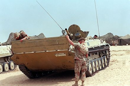 Two US Marines lower the trim vane on the front of an Iraqi BMP-1 captured during Operation Desert Storm, 17 March 1991