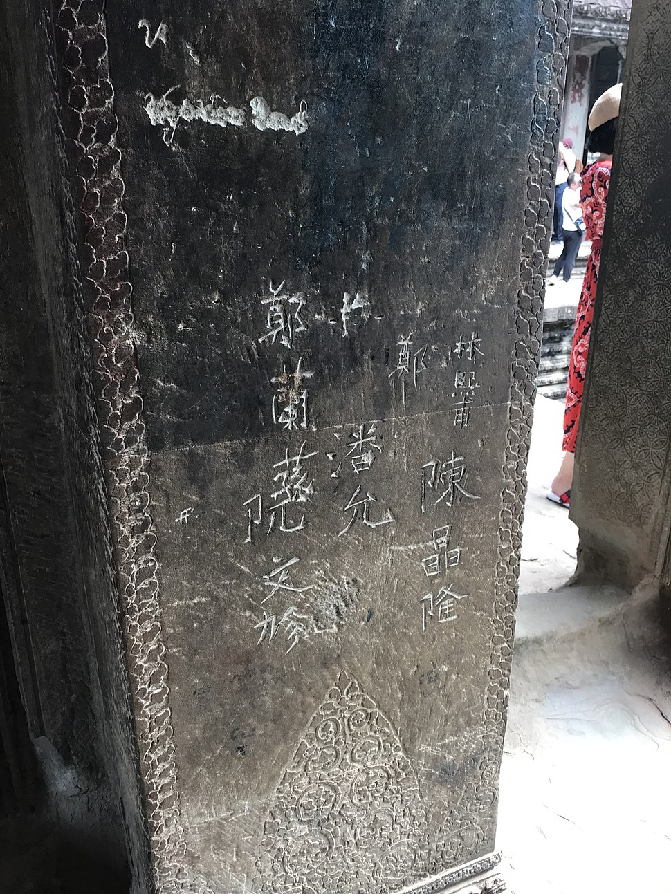 Carved grafitti in Angkor Wat left by Chinese tourists