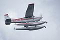 Cessna A185F N363JV Overhead 06 SNFSI FOF 15April2010 (14443697100).jpg