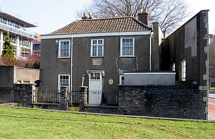 The wall at the right of the house where Chatterton was raised is that of the c. 1739 school where Chatterton's father was master. The school was demolished in 1939 to widen Pile Street into Redcliff Way, but the facade was rebuilt on the line of the former back wall. Chatterton house Bristol.jpg