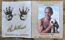 "Left panel shows two hand prints, handwritten name Chester Himes, and block text ""Missouri USA, Moraira.""  Right panel shows bust of muscular shirtless man with little hair, graying mustache, bare chest, dark skin, holding siamese cat.  Italic text is ""created by R. Mendorfer & Paco."""