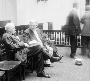 Spittoon - A Chicago courtroom scene, mid 1910s. A spittoon is seen on the floor at bottom right.