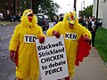 Chickens with sign (248435983).jpg