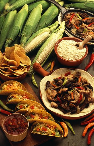 Tex-Mex - Examples of modern Tex-Mex dishes and ingredients: corn, tortilla chips, cheese, tacos, salsa, chilies, and beef dishes.