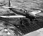 Corsicana Field - Fairchild PT-19 flying over airfield.jpg