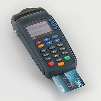 Payment terminal - PAX Technology S90 credit card terminal with a visa card inserted.
