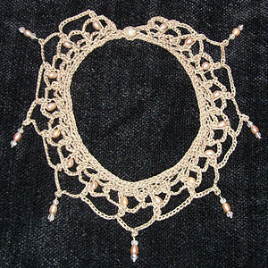 Necklace in crochet lace, freshwater pearls, silver, and rose quartz