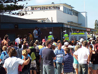 2005 Cronulla riots - Crowd with mounted police and ambulance in background. Near North Cronulla Beach First Aid room