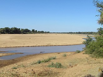 Limpopo River - The Limpopo river as seen from Crook's Corner in the Kruger National Park. Straight ahead of the river is Mozambique. Across the river is Zimbabwe.