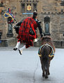 Crossed Swords Piper Jumps for Joy at the end of the Edinburgh Royal Military Tattoo MOD 45153158.jpg