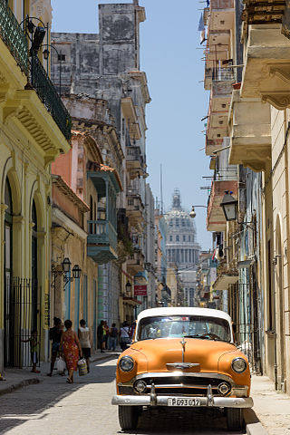 Old Havana from street level, with the Capitolio in the background.