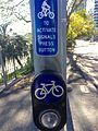 Cyclists signal push button in Brisbane, Australia.jpg