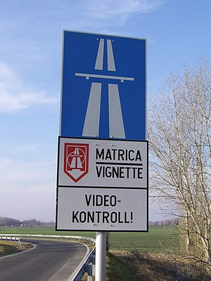 Vignette (road tax) - Motorway sign in Hungary. Electronic vignettes are checked by roadside cameras.
