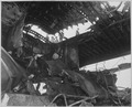 Damaged USS RANDOLPH resulting from a Japanese suicide attack. Damage to overhead hangar and flight deck aft. - NARA - 520655.tif