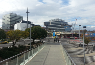 "Dandenong, Victoria - Dandenong CBD skyline (western edge) viewed from the railway station including the ex-Australian Taxation Office tower (tallest office building on the left), ""Municipal Hub"" (white building) and State Government Offices."