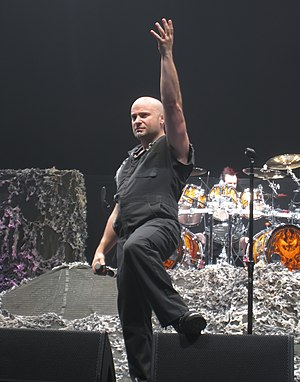 "Super Collider (album) - David Draiman of Disturbed and Device was asked to perform guest vocals on ""Dance in the Rain""."