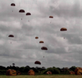 Daytime reenactment of the 82nd Air-borne Division's nocturnal D-Day jump.png