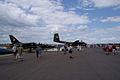 De Havilland CV-2B Caribou 62-4149 behind Aero Vodochody L-39C Albatros Playboy SNF 16April2010 (14630431805).jpg