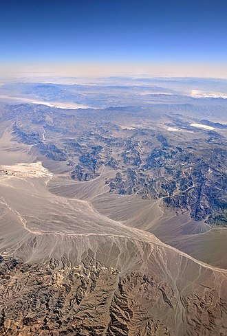 Bajada (geography) - Death Valley north of Stovepile Wells has bajadas on both sides of the valley, more well developed on the Panamint Range side (far side in this aerial view from the northeast).