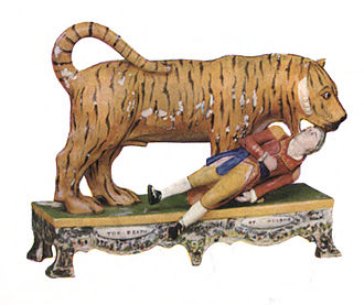 """Tipu's Tiger - """"Death of Munrow"""", Staffordshire pottery c. 1814 from the Walton school depicting a tiger mauling Lt. Hugh Munro, the only son of General Hector Munro (1726 – 1805)"""